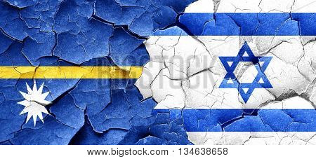 Nauru flag with Israel flag on a grunge cracked wall