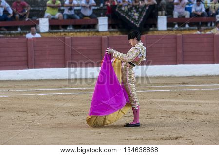 Andujar Spain - September 10 2011: The Spanish Bullfighter Daniel Luque bullfighting with the crutch in the Bullring of Andujar Spain