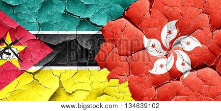 Mozambique flag with Hong Kong flag on a grunge cracked wall