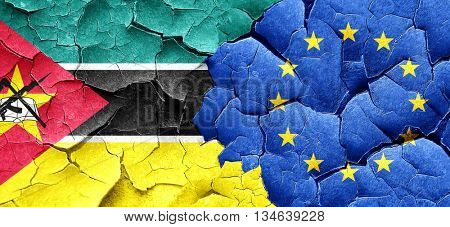 Mozambique flag with european union flag on a grunge cracked wal