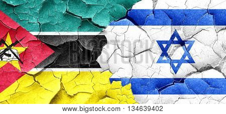 Mozambique flag with Israel flag on a grunge cracked wall