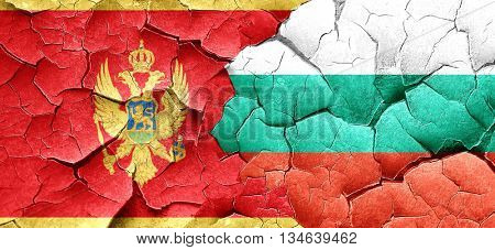 Montenegro flag with Bulgaria flag on a grunge cracked wall