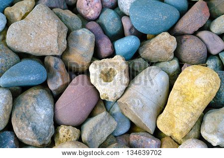 small colorful river rock landscaping pile close-up
