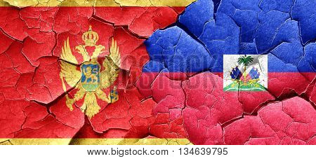 Montenegro flag with Haiti flag on a grunge cracked wall
