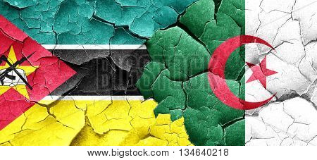 Mozambique flag with Algeria flag on a grunge cracked wall