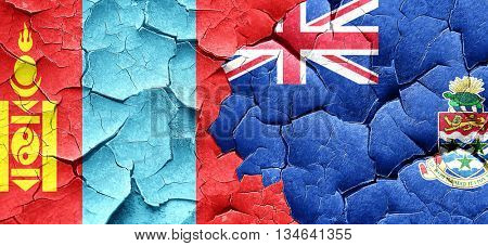 Mongolia flag with Cayman islands flag on a grunge cracked wall