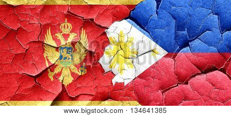 Montenegro flag with Philippines flag on a grunge cracked wall