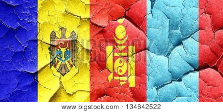 Moldova flag with Mongolia flag on a grunge cracked wall