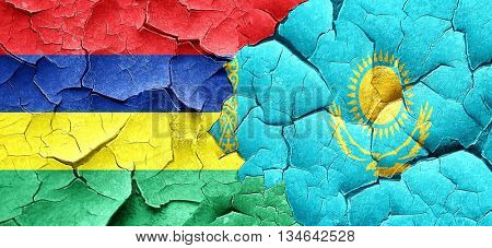 Mauritius flag with Kazakhstan flag on a grunge cracked wall