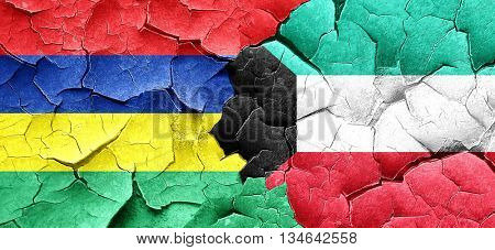 Mauritius flag with Kuwait flag on a grunge cracked wall