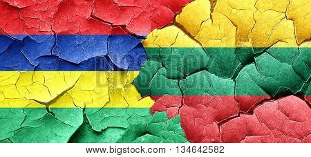 Mauritius flag with Lithuania flag on a grunge cracked wall
