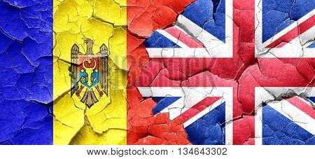 Moldova flag with Great Britain flag on a grunge cracked wall