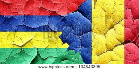 Mauritius flag with Romania flag on a grunge cracked wall