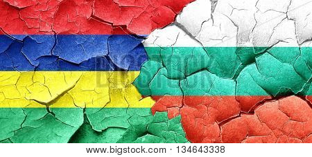 Mauritius flag with Bulgaria flag on a grunge cracked wall