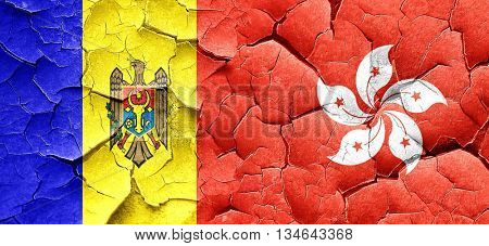 Moldova flag with Hong Kong flag on a grunge cracked wall