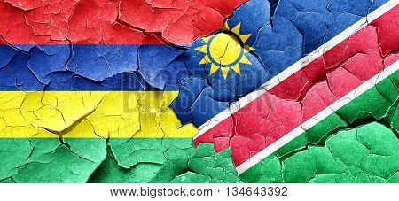 Mauritius flag with Namibia flag on a grunge cracked wall