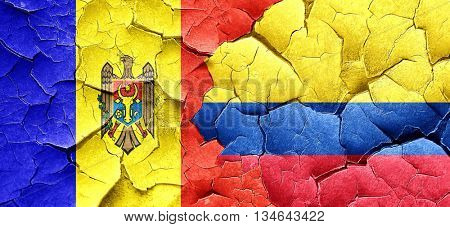 Moldova flag with Colombia flag on a grunge cracked wall