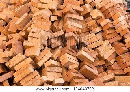 pile of red bricks. building materials background