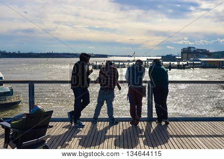 NEW YORK - MARCH 17, 2016: group of people at Pier 15 at daytime. Pier 15 is located east of South Street and FDR Drive in Lower Manhattan, New York City.