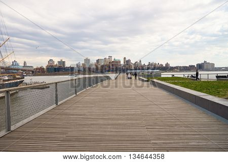 NEW YORK - MARCH 17, 2016: Pier 15 at daytime. Pier 15 is located east of South Street and FDR Drive in Lower Manhattan, New York City.