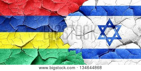 Mauritius flag with Israel flag on a grunge cracked wall