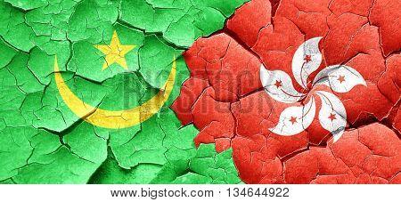 Mauritania flag with Hong Kong flag on a grunge cracked wall