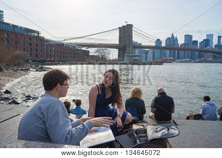 NEW YORK - CIRCA MARCH, 2016: outdoor lifestyle portrait of young people in Brooklyn, New York. The City of New York is the most populous city in the United States