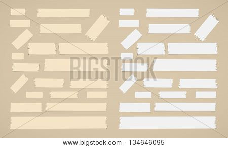 Pieces of different size sticky, adhesive masking tape are on brown background.