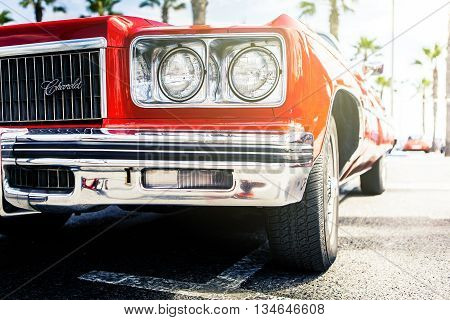 Benalmadena, Spain - June 21, 2015: Front view of classic Chevrolet car in red color, parked in Benalmadena (Spain), on June 21, 2015.