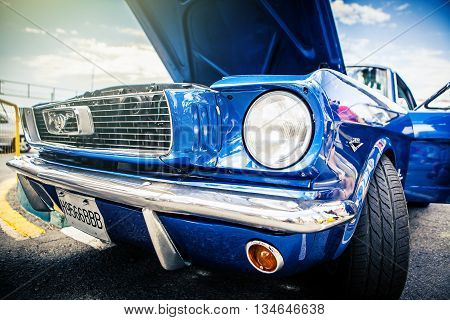 Benalmadena, Spain - June 21, 2015: Front view of classic Ford Mustang in blue color, parked in Benalmadena (Spain), on June 21, 2015.
