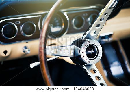 Benalmadena, Spain - June 21, 2015: Inside view of classic Ford Mustang, with focus on the steering wheel, in Benalmadena (Spain), on June 21, 2015.
