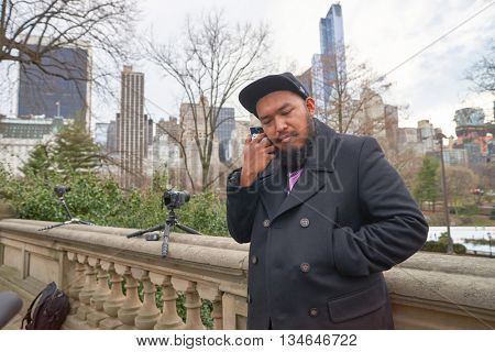 NEW YORK - CIRCA MARCH, 2016: outdoor portrait of man in Central Park. Central Park is an urban park in middle-upper Manhattan, within New York City.