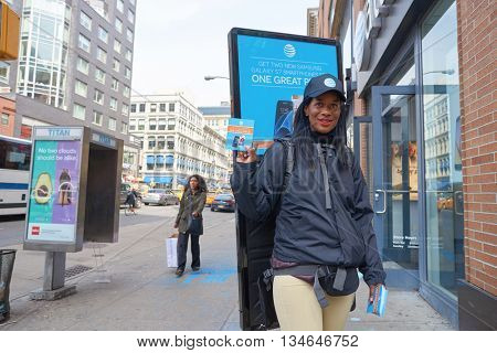 NEW YORK - CIRCA MARCH, 2016: woman with AT&T advertising poster panel. T&T Inc. is an American multinational telecommunications corporation, headquartered at Whitacre Tower in downtown Dallas, Texas.