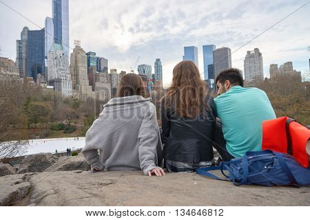 NEW YORK - CIRCA MARCH, 2016: outdoor lifestyle portrait of young people in Central Park. Central Park is an urban park in middle-upper Manhattan, within New York City.