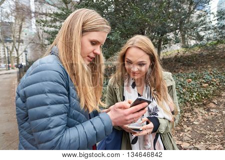 NEW YORK - CIRCA MARCH, 2016: outdoor portrait of young women in Central Park. Central Park is an urban park in middle-upper Manhattan, within New York City.