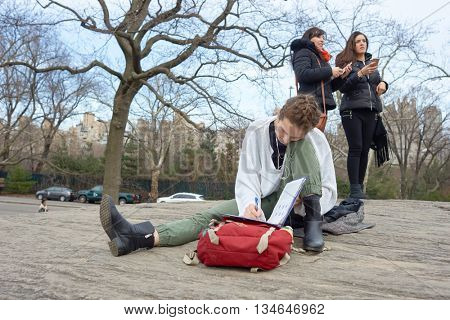 NEW YORK - CIRCA MARCH, 2016: outdoor portrait of young woman in Central Park. Central Park is an urban park in middle-upper Manhattan, within New York City.