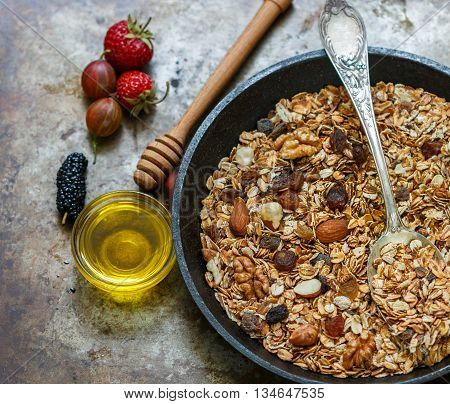 Homemade granola with raisins walnuts almonds and hazelnuts. Muesli. Fresh berries - strawberry gooseberry mulberry. Healthy Breakfast Top view