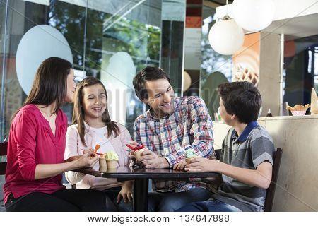 Family In Casuals Having Ice Creams In Shop