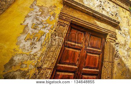 wooden door in Alghero old town Italy