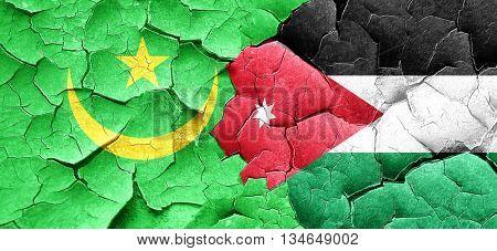 Mauritania flag with Jordan flag on a grunge cracked wall