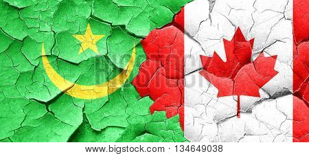 Mauritania flag with Canada flag on a grunge cracked wall