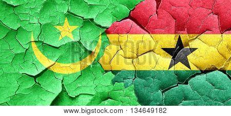 Mauritania flag with Ghana flag on a grunge cracked wall