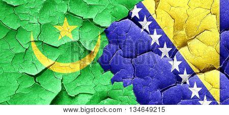 Mauritania flag with Bosnia and Herzegovina flag on a grunge cra