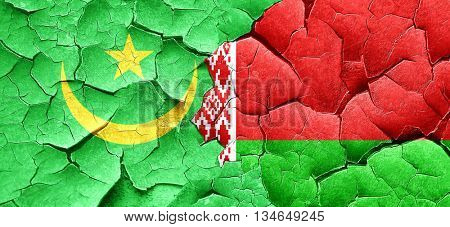 Mauritania flag with Belarus flag on a grunge cracked wall