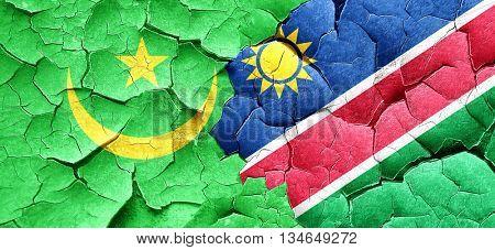 Mauritania flag with Namibia flag on a grunge cracked wall