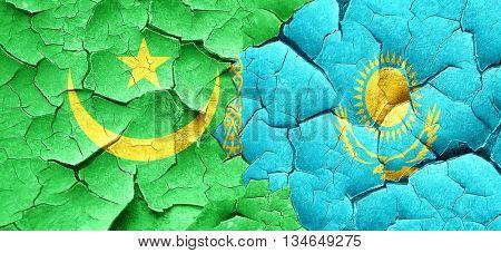 Mauritania flag with Kazakhstan flag on a grunge cracked wall