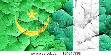 Mauritania flag with Nigeria flag on a grunge cracked wall