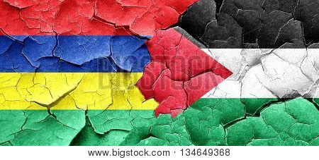Mauritius flag with Palestine flag on a grunge cracked wall
