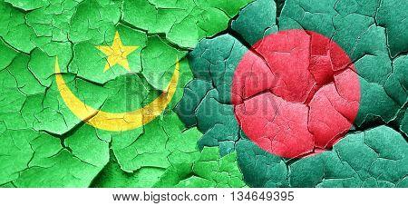 Mauritania flag with Bangladesh flag on a grunge cracked wall