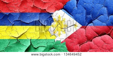 Mauritius flag with Philippines flag on a grunge cracked wall
